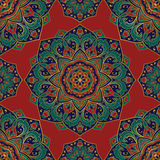 Pattern of mandalas for textile. Seamless  colorful pattern. East ornament with gold contour and colorful details on the red background. Design of mandalas for Stock Image