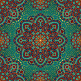 Pattern of mandalas for textile. Seamless  colorful pattern. East ornament with gold contour and colorful details on the turquoise background. Design of Royalty Free Stock Image
