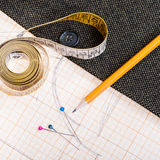 Pattern, measuring tape, pencil, pins, tweed coat Royalty Free Stock Image