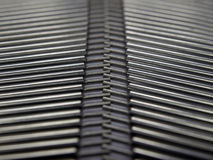 Pattern. Metallic cylinders placed in 2 rows Royalty Free Stock Photos