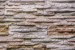 Pattern of Modern Slate stone Brick Wall Surfaced for background Stock Images