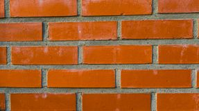 Pattern of a Modern wall made of cement and orange bricks, Construction industry background royalty free stock photo
