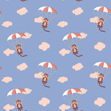 Pattern of monkeys with parachute. Rose Quartz and Serenity colo. Pattern of monkeys in the sky with parachute. Rose Quartz and Serenity colors Stock Photos