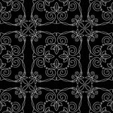 Pattern of monograms. Seamless pattern of monograms. White drawing of a pattern on a black background. traced vegetable theme lines, curves, intersections Royalty Free Stock Photo