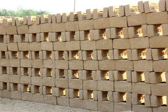 Pattern of mud bricks. Mud brick before burning on a workshop in India Royalty Free Stock Images