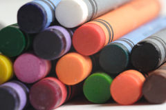A pattern of multicolored crayons. A pile of multicolored crayons Royalty Free Stock Image