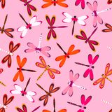 Pattern with multiolored dragonflies. Seamless pattern with colorful dragonflies on pink, bright background with multicolor dragonflies Stock Photos
