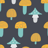 Pattern of mushroom. Seamless pattern of mushrooms. Multicolored mushrooms on a dark background, painted in the style of doodle Royalty Free Stock Photo