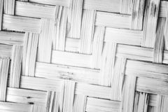 Pattern nature for background of handicraft weave white texture. Wicker surface. Closeup view. Darker from the centre Stock Images