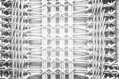 Pattern nature for background of handicraft weave white texture. Wicker surface. Darker from the centre Stock Photo