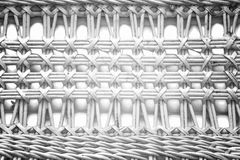 Pattern nature for background of handicraft weave white texture. Wicker surface. Darker from the centre Stock Images