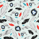 Pattern of nests and feathers. Seamless graphic design from the nests and feathers on a light blue background Stock Photography