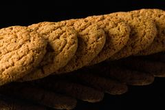 Pattern of oatmeal cookies isolated on a black background Royalty Free Stock Photos