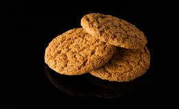 Pattern of oatmeal cookies isolated on a black background Royalty Free Stock Photo