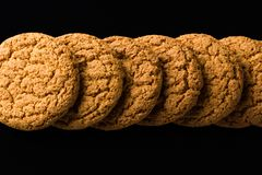 Pattern of oatmeal cookies isolated on a black background Stock Image