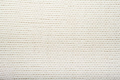 Pattern Of The White Knitted Fabric Texture. Woolen Background. Royalty Free Stock Image