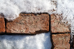 Pattern of old bricks in snow and ice 4 Stock Photo