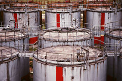 Pattern of old large oil storage tanks Stock Image