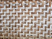 Pattern of old Thai house wall for background and texture. Made. Of bamboo plant stalks stock image
