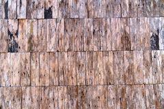 Pattern of old wooden house wall made from small wood pieces connected together. stock image