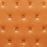 Pattern of orange leather seat upholstery Stock Photos