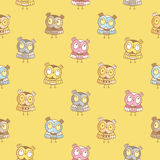 Pattern with owls. Seamless pattern with cute cartoon owls on yellow background. Funny forest birds. Little colorful owlets. Children's illustration. Vector Stock Photo