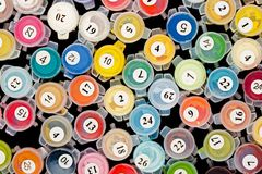 Paint containers for painting by numbers. Pattern of paint containers for painting by numbers Royalty Free Stock Photo