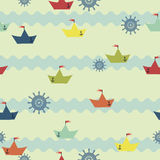 Pattern with paper boats on the background of the waves Royalty Free Stock Images
