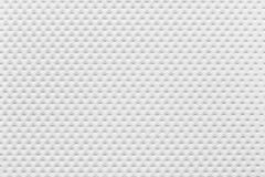 Pattern of paper perforated sheets white color. Stock Photography