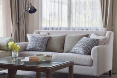 Pattern pillows setting on beige sofa in living room Stock Images