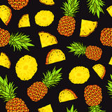 Pattern of pineapples on a black background Stock Photos