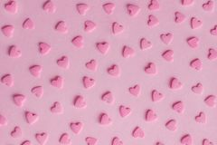Pattern. Pink confectionery hearts on pink background, texture Royalty Free Stock Photos