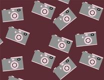 Pattern of pink-gray, hipster, beautiful, vintage retro cameras scattered and turned in different directions on a claret backgroun. D. Seamless texture. Vector Stock Images