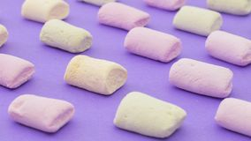 Pattern with pink green and yellow with marshmallows. On violet background Royalty Free Stock Photos