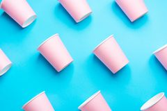 Pattern from Pink Paper Drinking Cups Arranged Diagonally on Mint Blue Backgrounds. Birthday Party Celebration Abstract Fashion. Baby Shower Concept. Pastel stock images