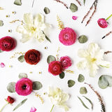 Pattern with pink and red roses or ranunculus, white tulips and green leaves on white background Stock Images