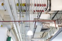 Pipes of air conditioning and ceiling electric system stock photo