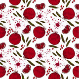 Pattern with Pomegranate. Seamless pattern with pomegranate part of pomegranate seeds and leaves of pomegranate with splashes of juice ranatovogo in retro style Stock Photos