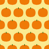Pattern with pumpkins. Seamless pattern with repeating orange pumpkins arranged in staggered rows and isolated on ginger background. Ideal for holiday decoration Royalty Free Stock Images