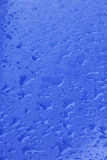 Pattern of raindrops on blue surface Stock Image