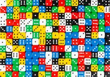 Pattern of random ordered polychrome dices. Pattern background of random ordered black, white, red, yellow, blue and green dices royalty free stock photography