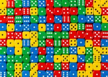 Pattern of random ordered red, yellow, green and blue dices royalty free stock images