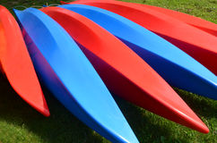 Pattern of Red and Blue Kayaks. Red and Blue Kayaks forming fan shaped geometric pattern Stock Photo