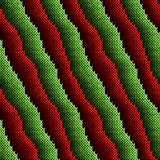 Pattern with red and green alternating stripes. Alternating stripes in red and green hues are forming seamless knitting vector pattern as a fabric texture Royalty Free Stock Image