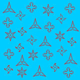 Pattern of Red Ninja Weapons Shuriken Silhouette  on Blue Royalty Free Stock Image