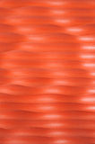 Pattern of red waves of a wall Royalty Free Stock Images