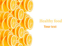 Pattern of repeating stacks of sliced oranges on a white background. Pile of slices of juicy orange. Stock Image