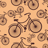 Pattern of retro hipster styled bicycle on a coffee background  Royalty Free Stock Images