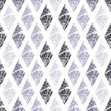 Pattern of rhombuses with abstract texture. Royalty Free Stock Photography