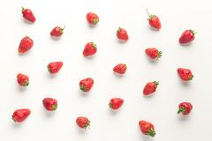Pattern of ripe juicy red strawberries. On white table Stock Image